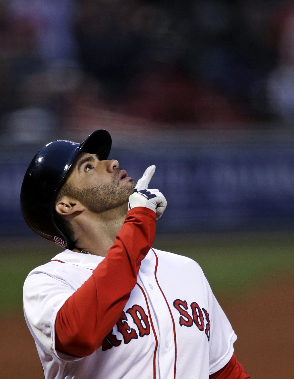 Boston Red Sox's J.D. Martinez points upward as he crosses home plate on his three-run home run off Oakland Athletics starting pitcher Trevor Cahill d