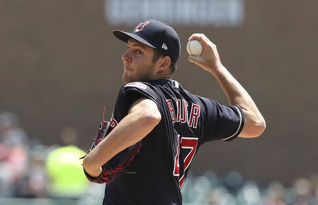 Cleveland Indians starting pitcher Trevor Bauer throws during the first inning of a baseball game against the Detroit Tigers, Wednesday, May 16, 2018,