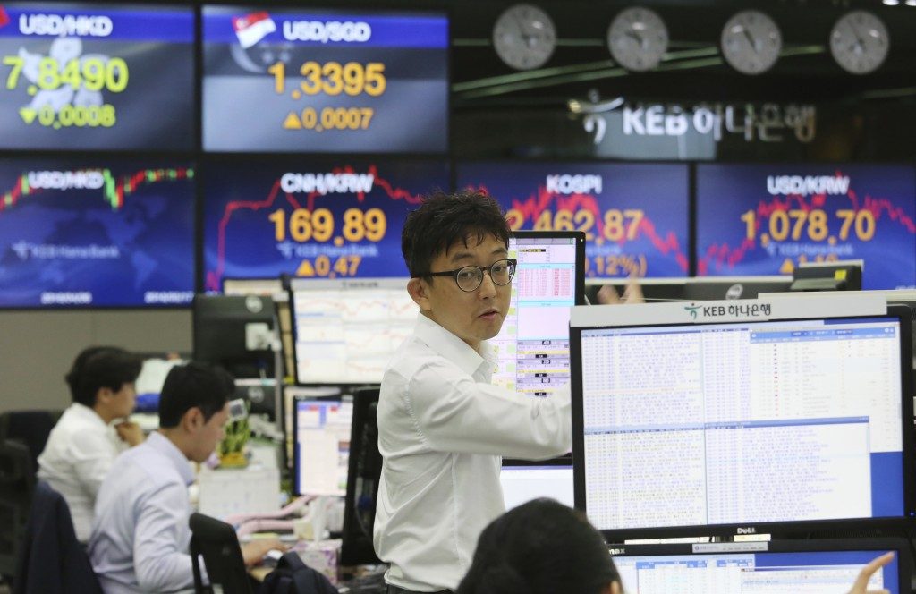 A currency trader works at the foreign exchange dealing room of the KEB Hana Bank headquarters in Seoul, South Korea, Thursday, May 17, 2018. Asian st...