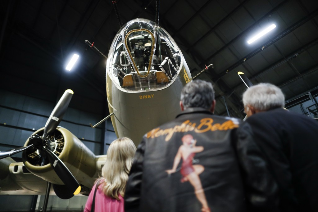 """Visitors gather for a private viewing of the Memphis Belle, a Boeing B-17 """"Flying Fortress,"""" at the National Museum of the U.S. Air Force, Wednesday,"""