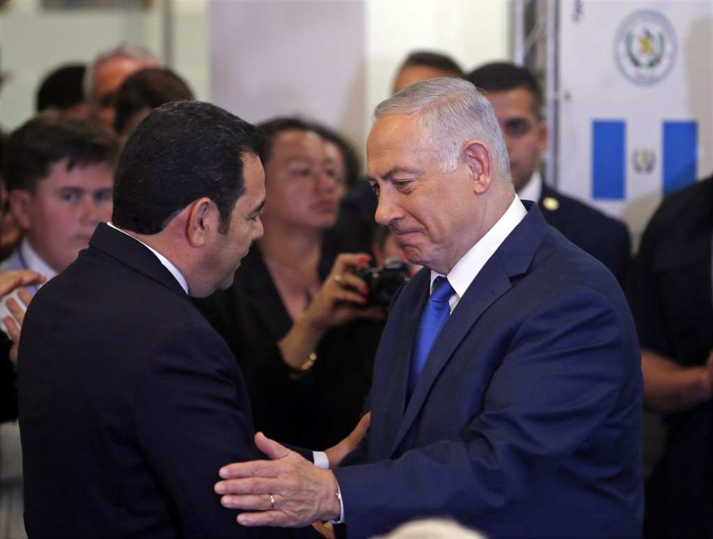 Israeli Prime Minister Benjamin Netanyahu, right, speaks to Guatemalan President Jimmy Morales ahead of the dedication ceremony of the embassy of Guat