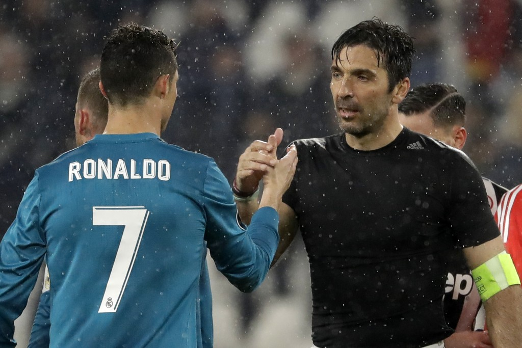 FILE - In this Tuesday, April 3, 2018 filer, Juventus goalkeeper Gianluigi Buffon, right, shakes hands with Real Madrid's Cristiano Ronaldo after the