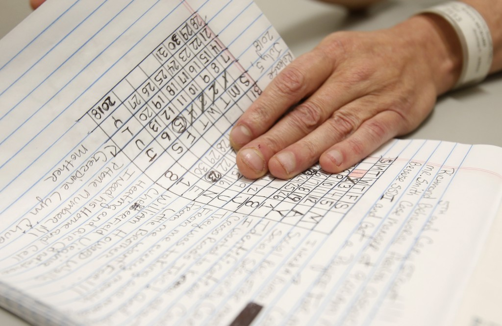 In this Tuesday, May 1, 2018 photo, inmate Richard Walls holds a page of notes during an interview in the Richmond City Jail in Richmond, Va. A federa