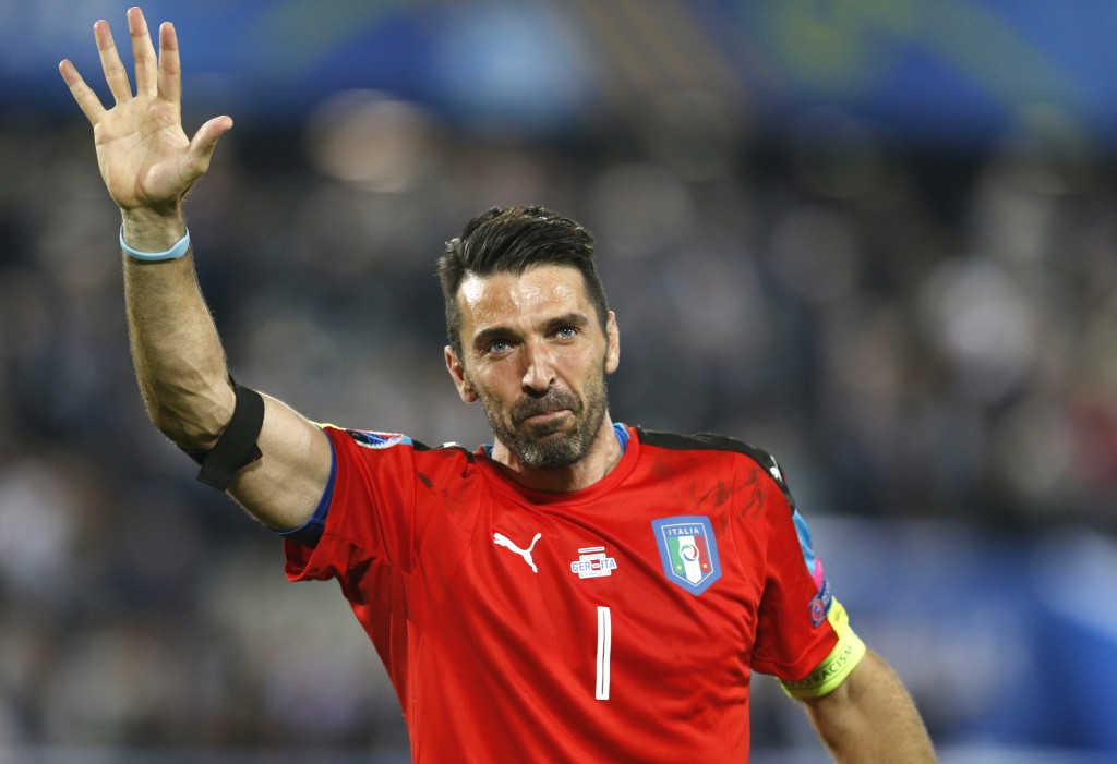 FILE - In this Saturday, July 2, 2016 file photo, Italy goalkeeper Gianluigi Buffon waves as he leaves the pitch after losing the Euro 2016 quarterfin