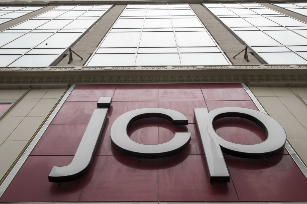 In this Wednesday, May 16, 2018, photo, the JC Penney logo is seen hanging outside the Manhattan mall in New York.  J.C. Penney Co. reports earnings o