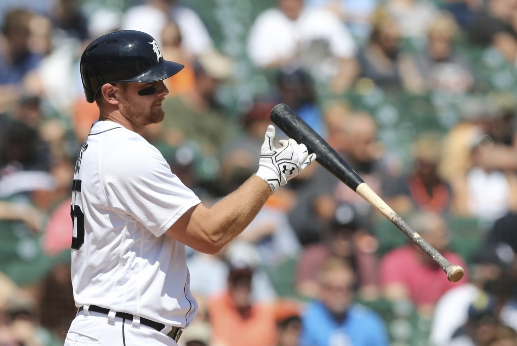 Detroit Tigers' John Hicks tosses his bat after striking out in the seventh inning of a baseball game against the Cleveland Indians, Wednesday, May 16