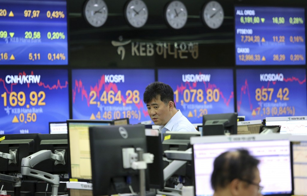 A currency trader watches monitors at the foreign exchange dealing room of the KEB Hana Bank headquarters in Seoul, South Korea, Thursday, May 17, 201...