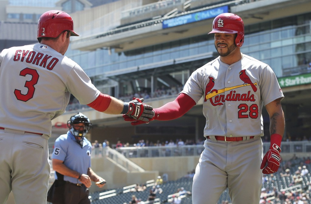 St. Louis Cardinals' Tommy Pham, right, is congratulated by Jedd Gyorko after Pham scored on a two-run single by Dexter Fowler off Minnesota Twins pit