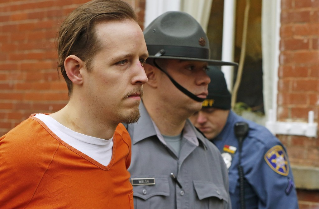 FILE – In this Oct. 31, 2014, file photo, Eric Frein, left, is escorted out by police after his arraignment at the Pike County Courthouse in Milford,
