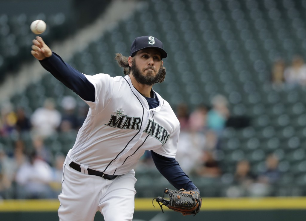 Seattle Mariners starting pitcher Christian Bergman throws against the Texas Rangers during the first inning of a baseball game, Wednesday, May 16, 20