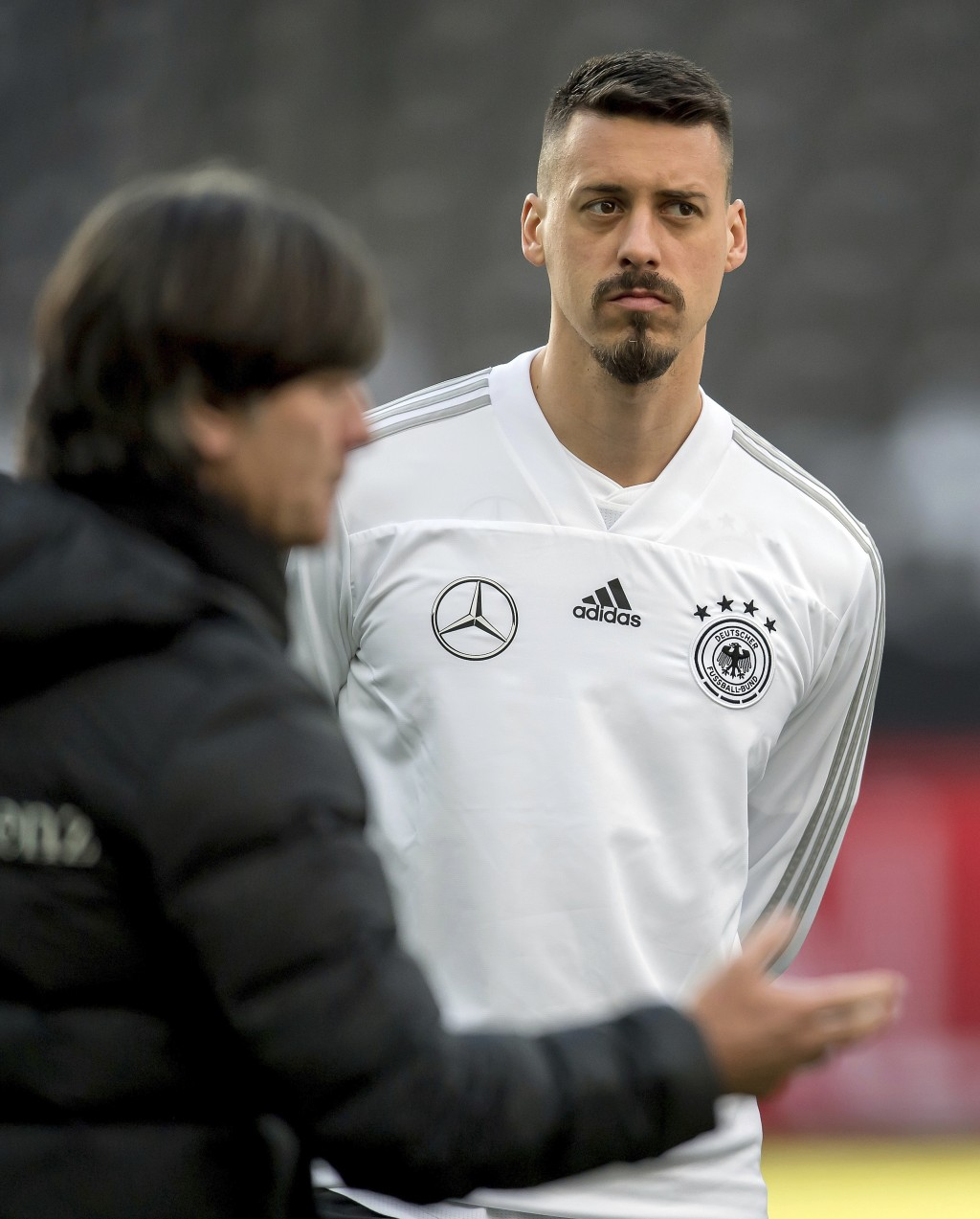 File -- In this Monday, March 26, 2018 photo Germany's head coach Joachim Loew, left, and player Sandro Wagner, right, attend a training session of th