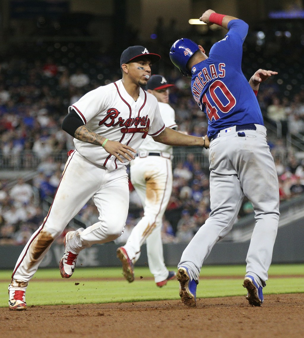 Atlanta Braves' Johan Camargo tags Chicago Cubs Willson Contreras out in a rundown between first and second during the sixth inning of a baseball game