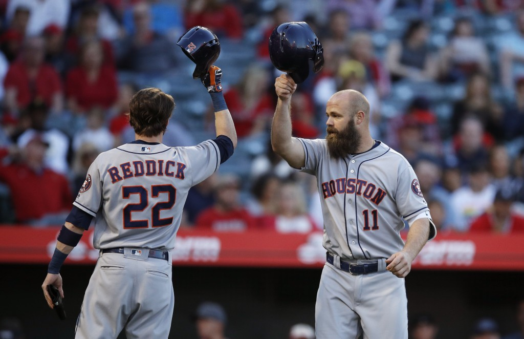 Houston Astros' Evan Gattis, right, celebrates his two-run home run with Josh Reddick during the second inning of the team's baseball game against the
