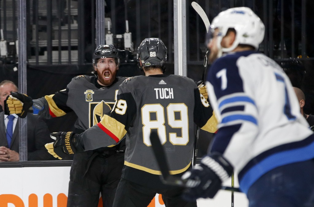 Vegas Golden Knights left wing James Neal, left, celebrates with right wing Alex Tuch (89) after scoring during the second period of Game 3 of the NHL
