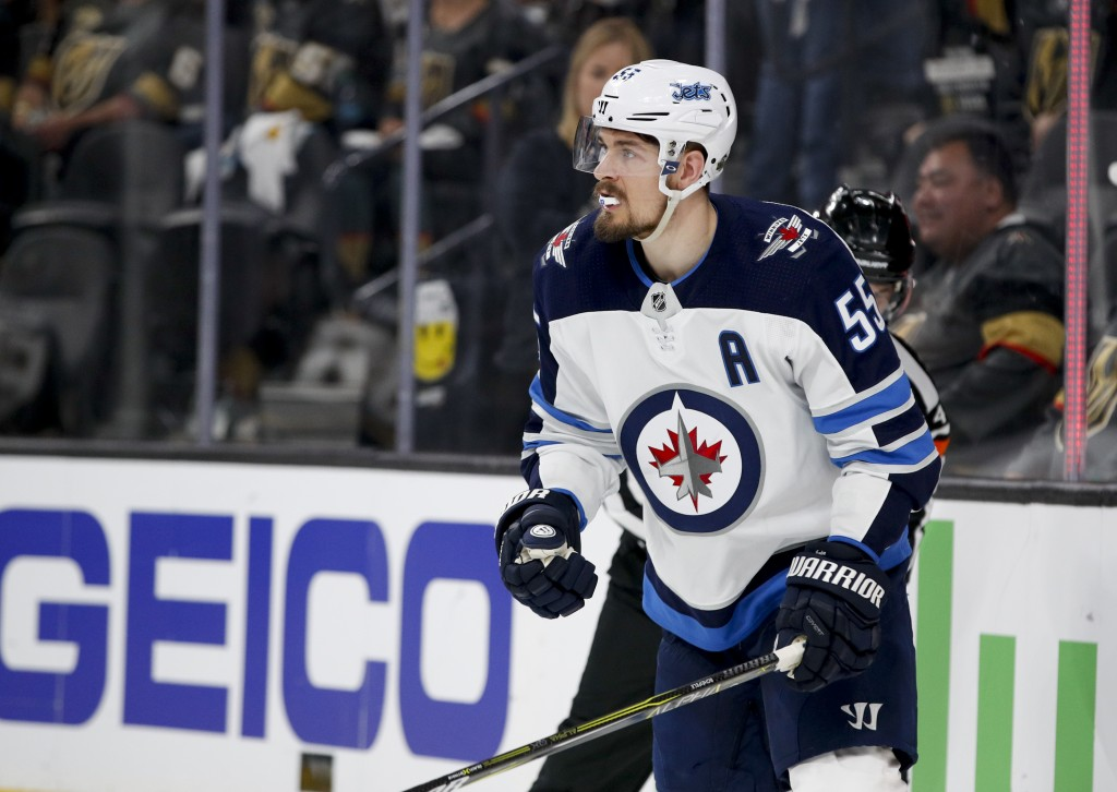 Winnipeg Jets center Mark Scheifele celebrates after scoring against the Vegas Golden Knights during the third period of Game 3 of the NHL hockey play