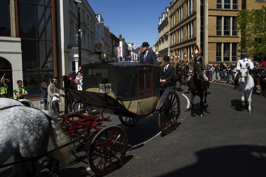 A carriage is driven through the streets of Windsor, England during a rehearsal for the procession of the upcoming wedding of Britain's Prince Harry a