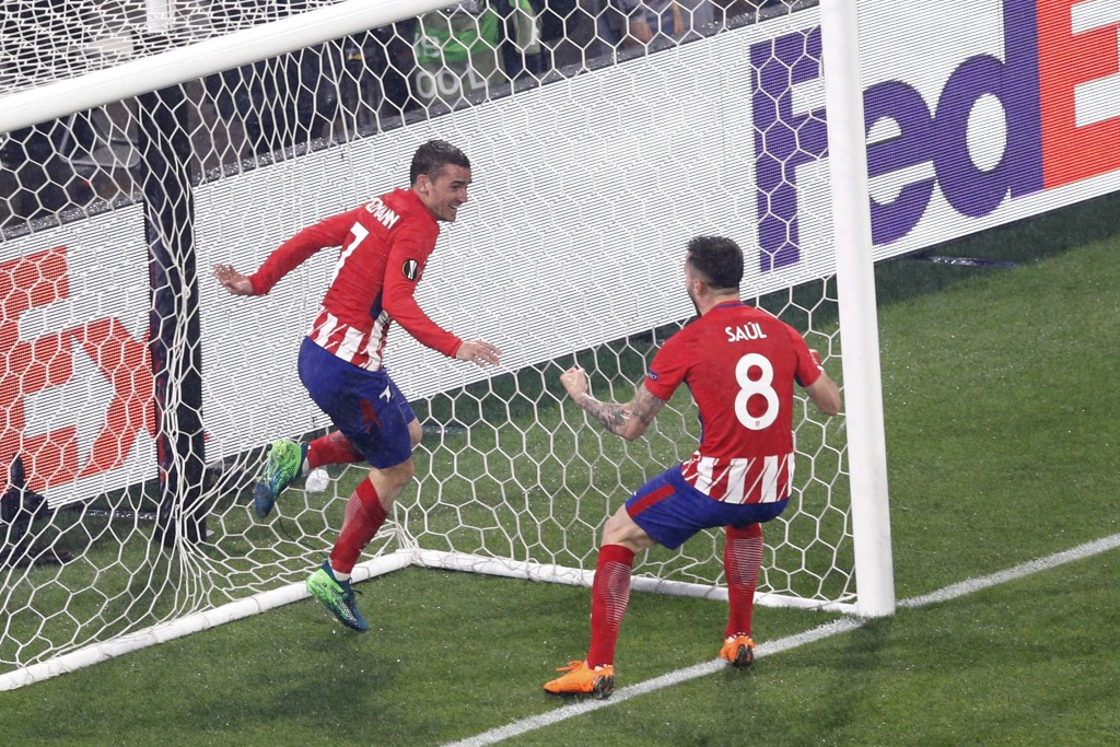Atletico's Antoine Griezmann, left, celebrates with teammate Saul Niguez his side second goal during the Europa League Final soccer match between Mars