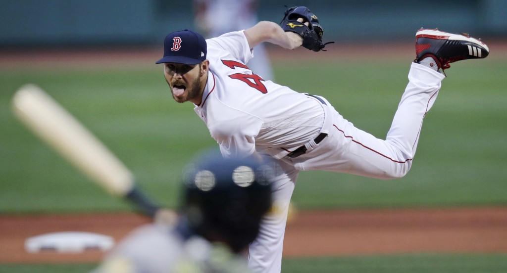 Boston Red Sox starting pitcher Chris Sale delivers during the first inning of the team's baseball game against the Oakland Athletics at Fenway Park i