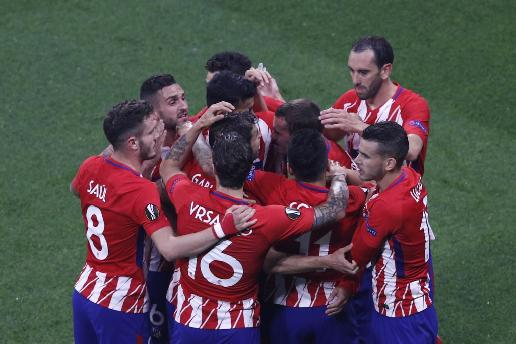 Atletico players celebrate teammate Antoine Griezmann's opening goal during the Europa League Final soccer match between Marseille and Atletico Madrid