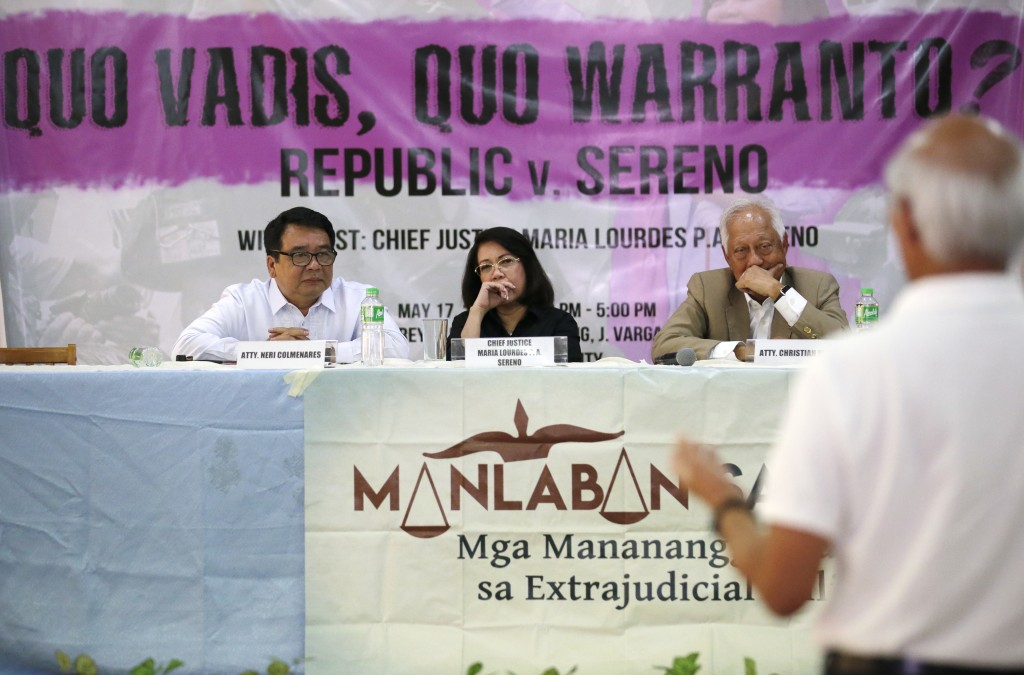 Ousted Philippine Supreme Court Chief Justice Maria Lourdes Sereno, center, listens to questions during a forum at the Integrated Bar of the Philippin
