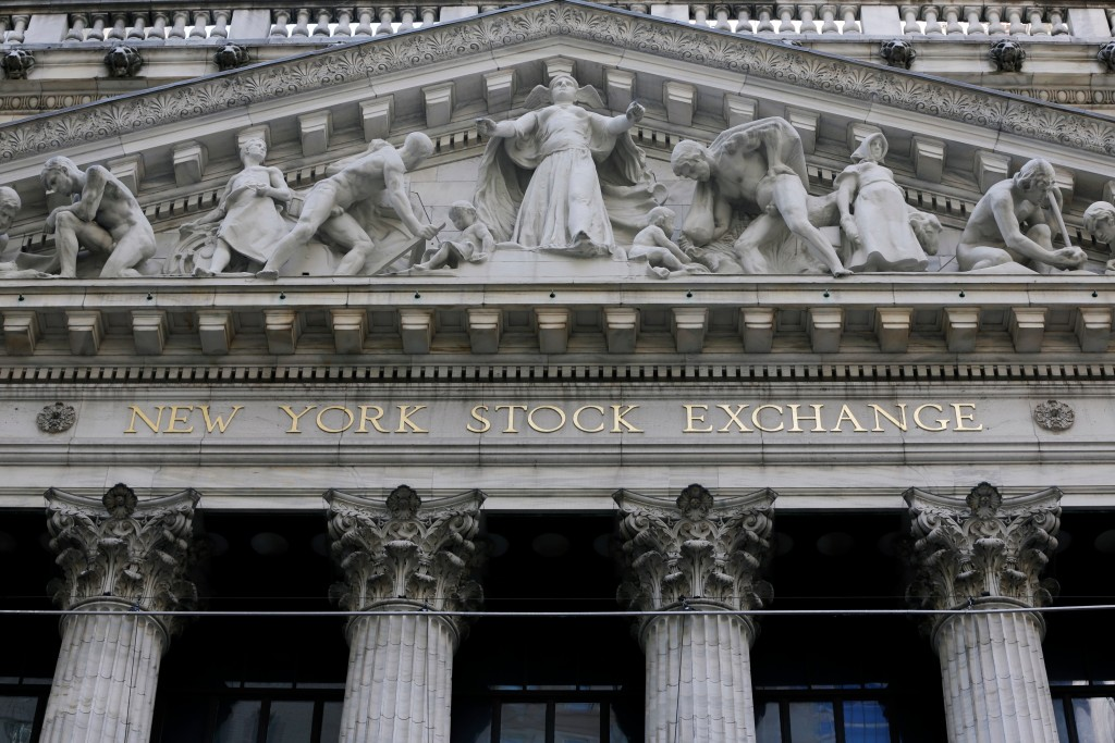 FILE- This April 5, 2018, file photo shows the facade of the New York Stock Exchange. The U.S. stock market opens at 9:30 a.m. EDT on Thursday, May 17