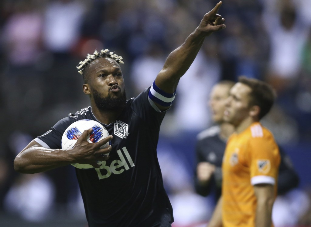 FILE - In this Friday, May 11, 2018, file photo, Vancouver Whitecaps defender Kendall Waston celebrates his goal against the Houston Dynamo during the