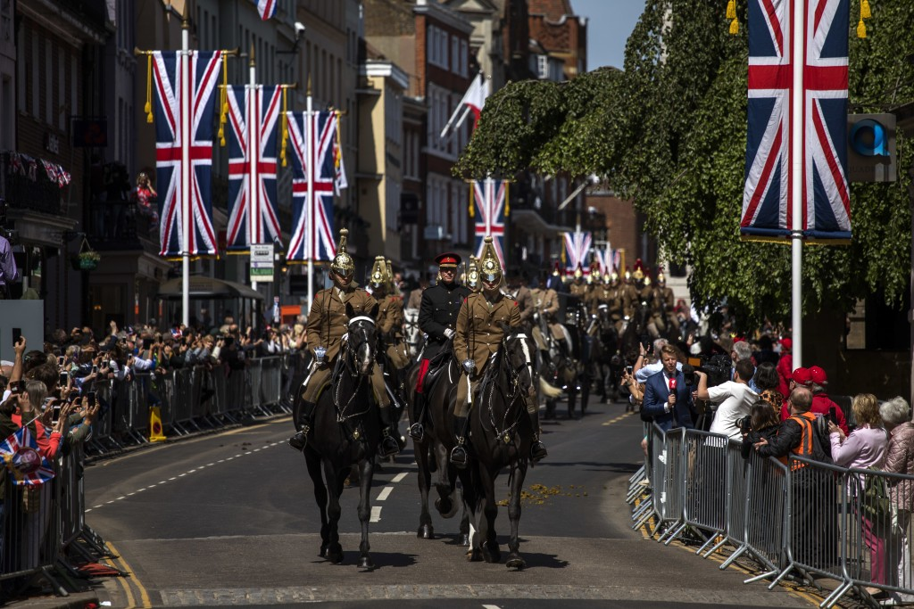 Members of the armed forces ride horses during a parade rehearsal, ahead of Prince Harry and Meghan Markle's wedding in Windsor, England, Thursday, Ma