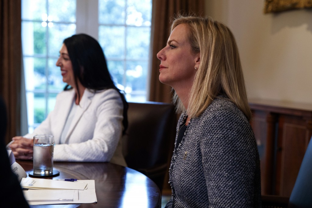 Secretary of Homeland Security Kirstjen Nielsen listens as President Donald Trump speaks during a roundtable on immigration policy in California, in t