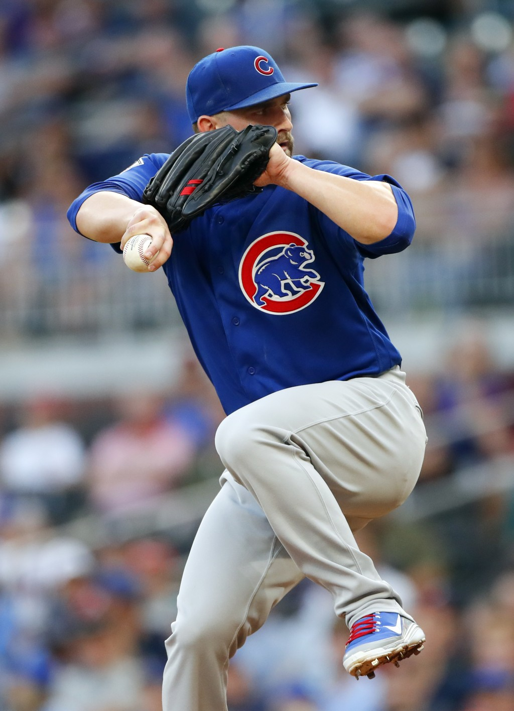 Chicago Cubs starting pitcher Tyler Chatwood winds up during the first inning of the team's baseball game against the Atlanta Braves on Wednesday, May