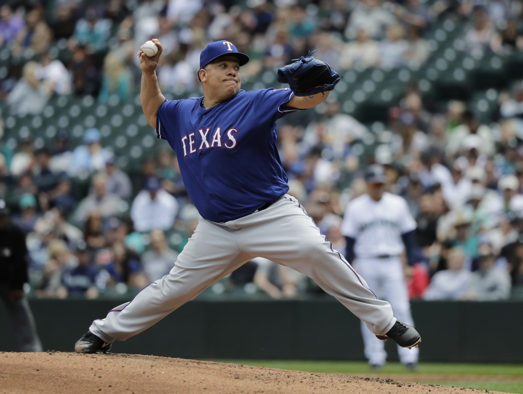 Texas Rangers starting pitcher Bartolo Colon throws to a Seattle Mariners batter during the third inning of a baseball game Wednesday, May 16, 2018, i