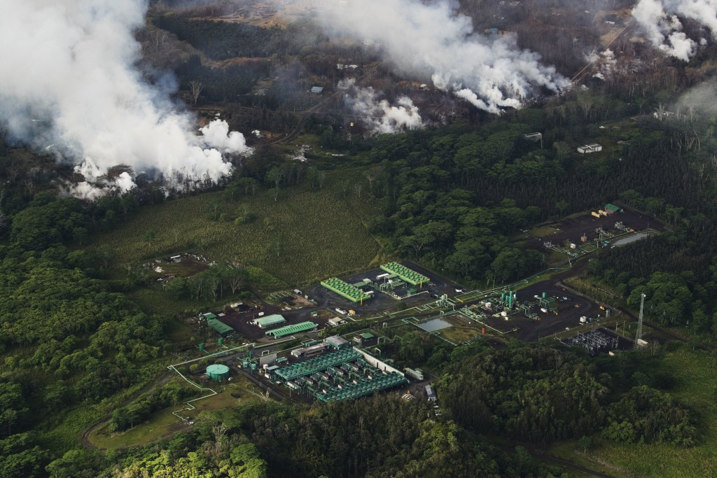 An aerial view of Hawaii's Kilauea East Rift zone and the Puna Geothermal Venture plant is seen, Wednesday, May 16, 2018. Earthquakes were damaging ro...