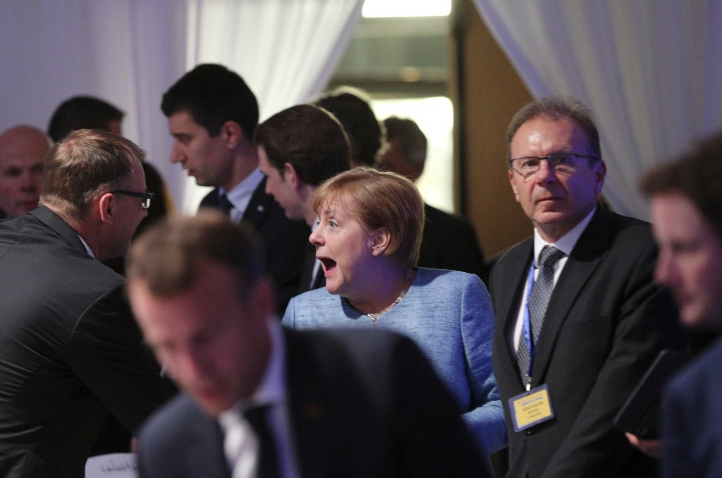 German Chancellor Angela Merkel, center, arrives for a dinner with EU and Western Balkan heads of state at the Sofia Tech Park in Sofia, Bulgaria, Wed