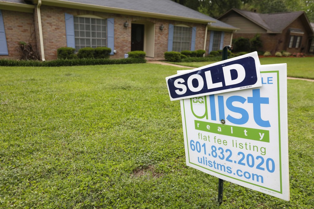 FILE- This April 23, 2018, file photo shows a sold sign in front of a home in Jackson, Miss. On Thursday, May 17, Freddie Mac reports on the week's av
