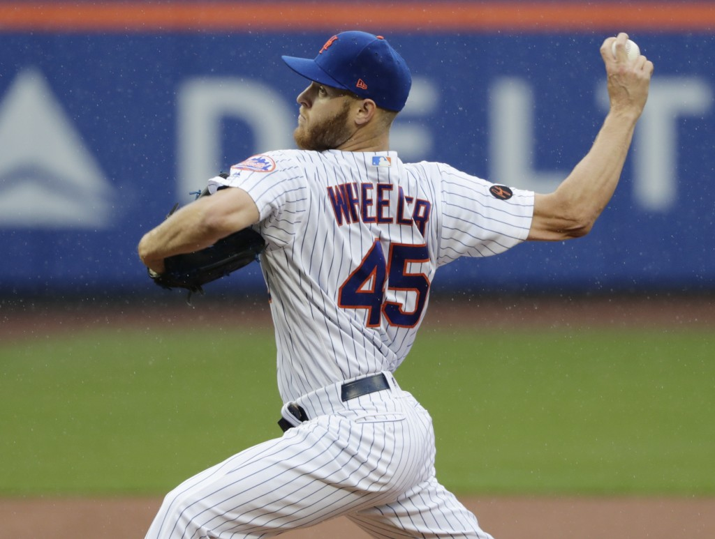 New York Mets' Zack Wheeler (45) delivers a pitch during the first inning of a baseball game against the Toronto Blue Jays, Wednesday, May 16, 2018, i