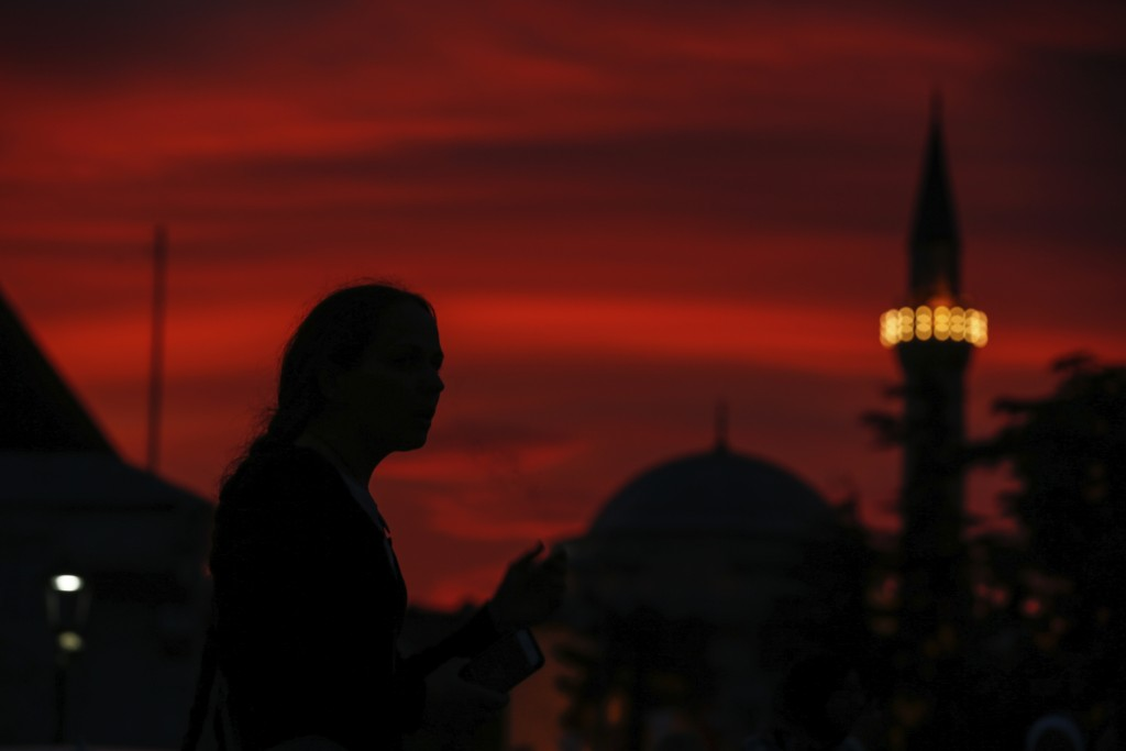 People walk in the historic Sultanahmet district of Istanbul, Wednesday, May 16, 2018 on the first day of the fasting month of Ramadan. Muslims throug...