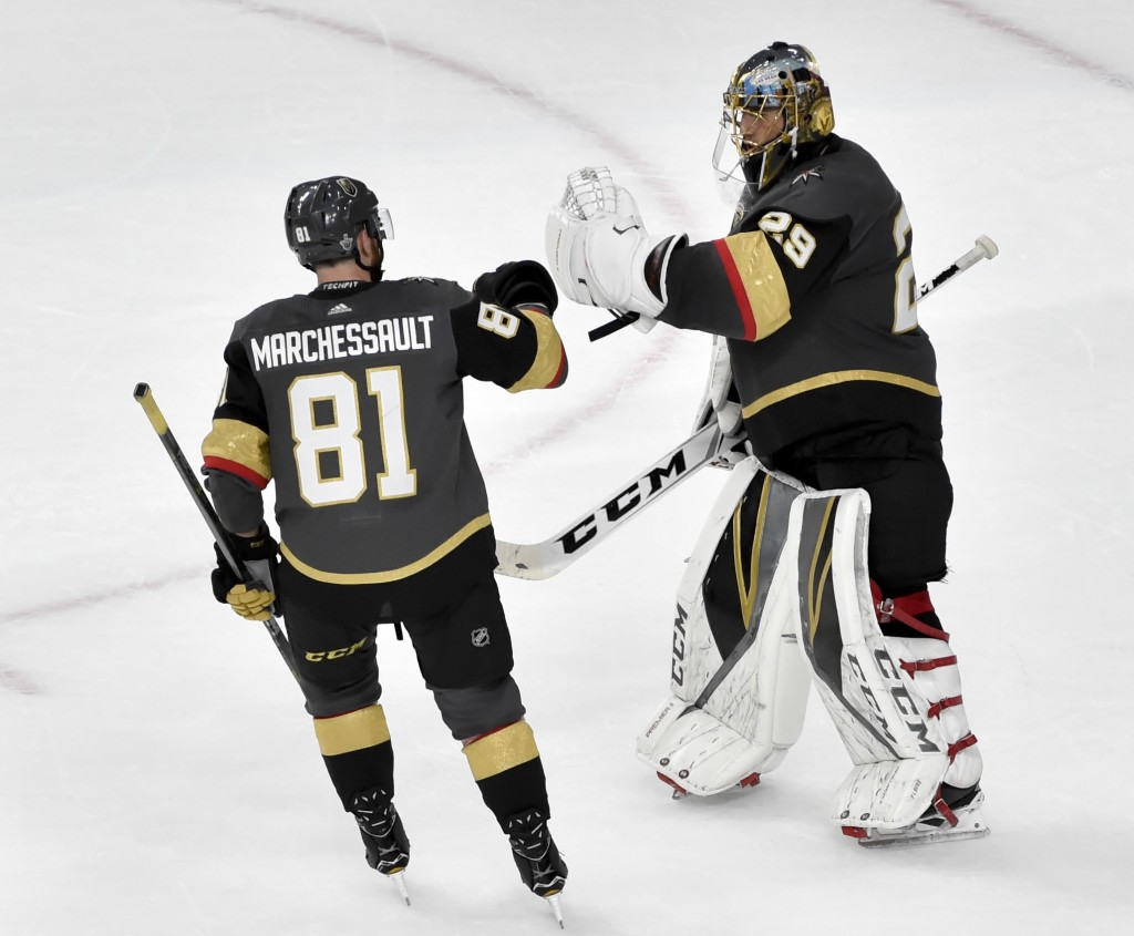 Vegas Golden Knights center Jonathan Marchessault, left, celebrates with goaltender Marc-Andre Fleury after the teams 4-2 win against the Winnipeg Jet