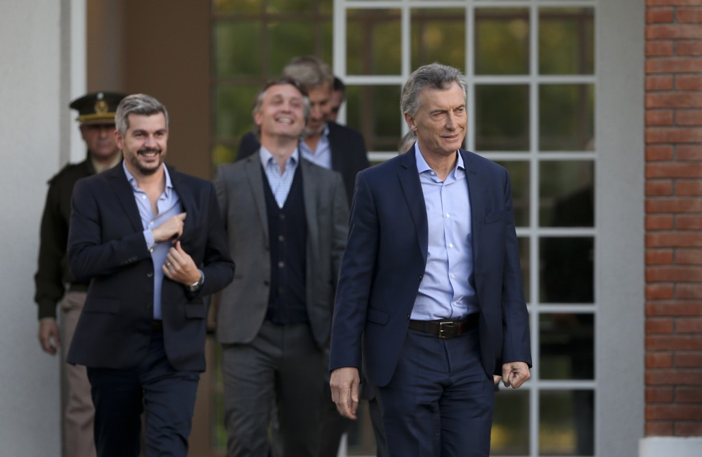 Argentina's President Mauricio Macri walks from the presidential residence to attend a press conference in Buenos Aires, Argentina, Wednesday, May 16,