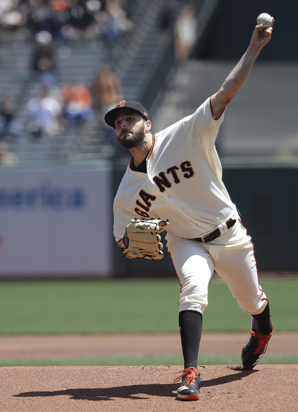 San Francisco Giants pitcher Andrew Suarez throws against the Cincinnati Reds during the first inning of a baseball game in San Francisco, Wednesday,