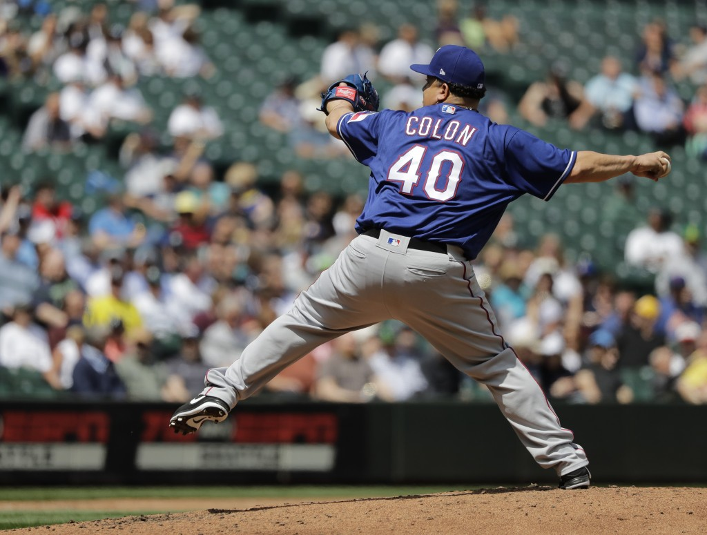 Texas Rangers starting pitcher Bartolo Colon throws against the Seattle Mariners during the fifth inning of a baseball game, Wednesday, May 16, 2018,