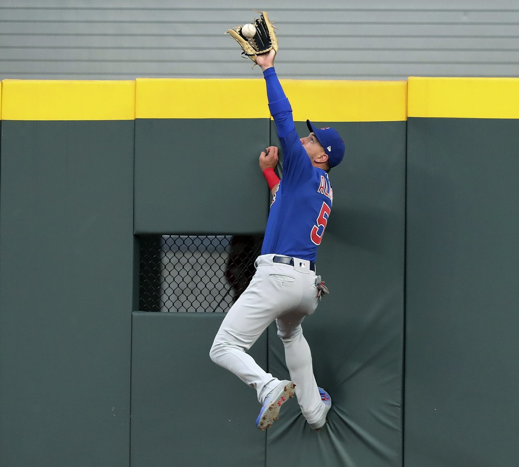 Chicago Cubs center fielder Albert Almora Jr. goes to the wall to rob Atlanta Braves' Tyler Flowers of a home run during the second inning of a baseba
