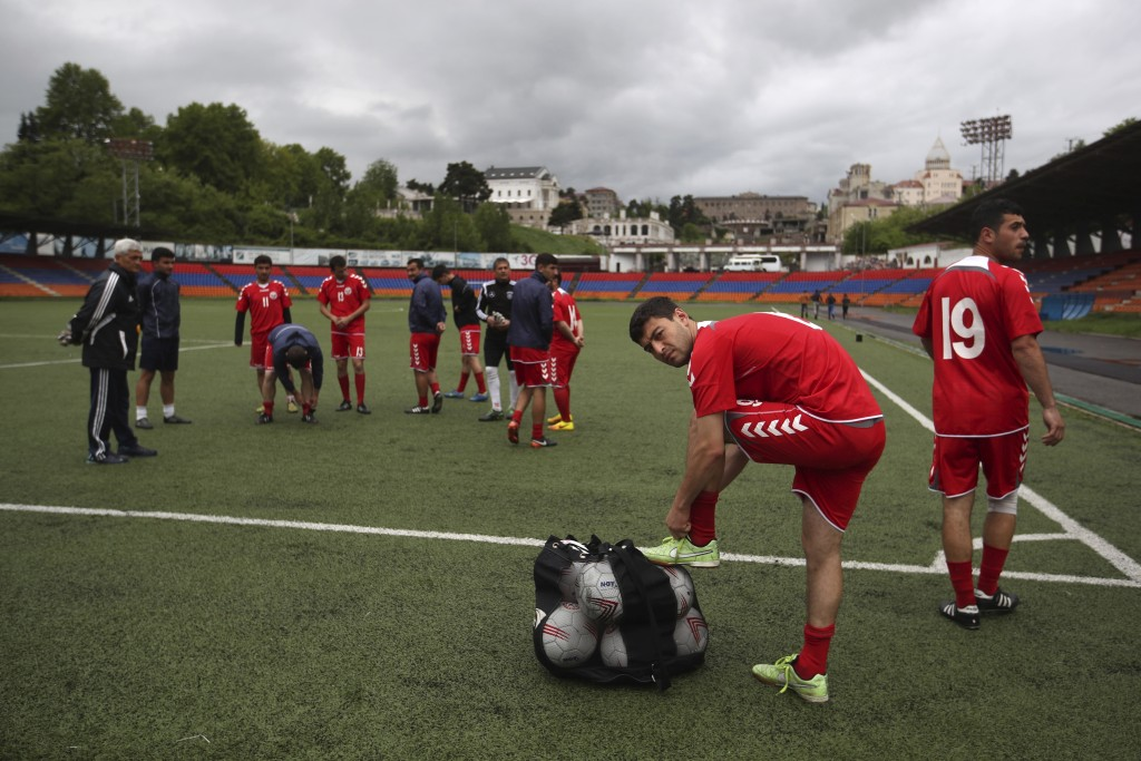 In this Friday, May 11, 2018 photo, players of the soccer national team of the self-proclaimed Republic of Artsakh prepare for a training session, in