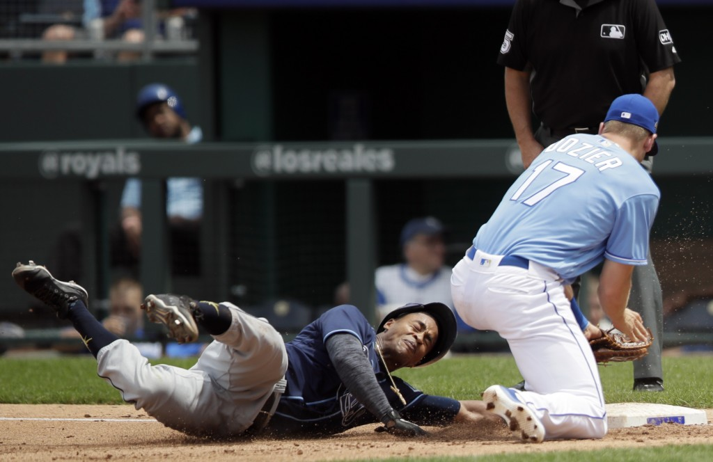 Tampa Bay Rays' Mallex Smith, left, dives back to the bag ahead of the attempted pick off tag by Kansas City Royals first baseman Hunter Dozier (17) d