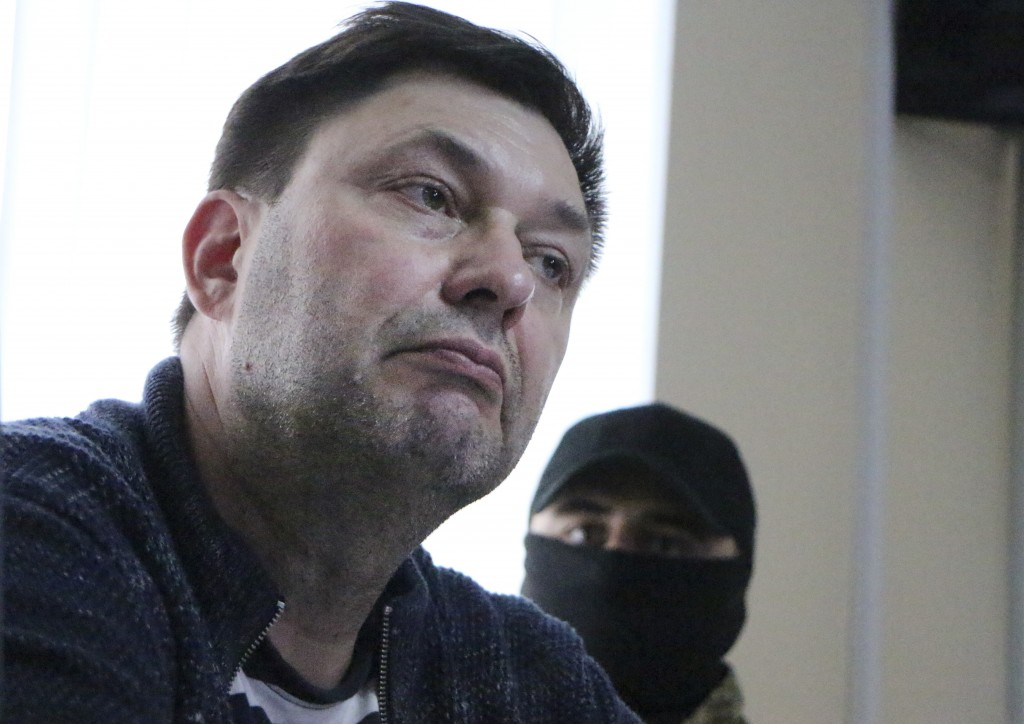 Kirill Vyshinskiy, bureau chief of RIA Novosti news agency in Ukraine, listens to lawyer in a court room in Kherson, Ukraine, Thursday, May 17, 2018.
