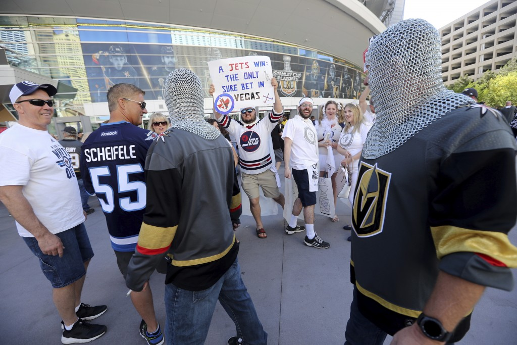 Fans of the Winnipeg Jets and of the Vegas Golden Knights walk pass each other outside the arena before Game 3 of the NHL hockey playoffs Western Conf