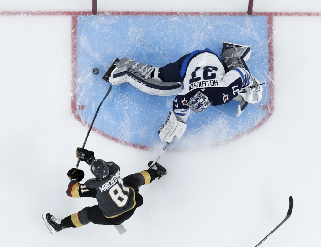 Vegas Golden Knights center Jonathan Marchessault scores past Winnipeg Jets goaltender Connor Hellebuyck during the first period of Game 3 of the NHL