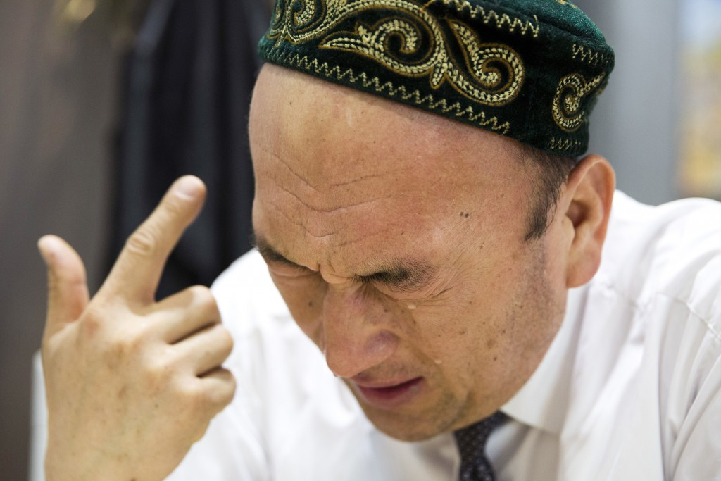 In this March 29, 2018, photo, Omir Bekali cries as he details the psychological stress endured while in a Chinese internment camp during an interview