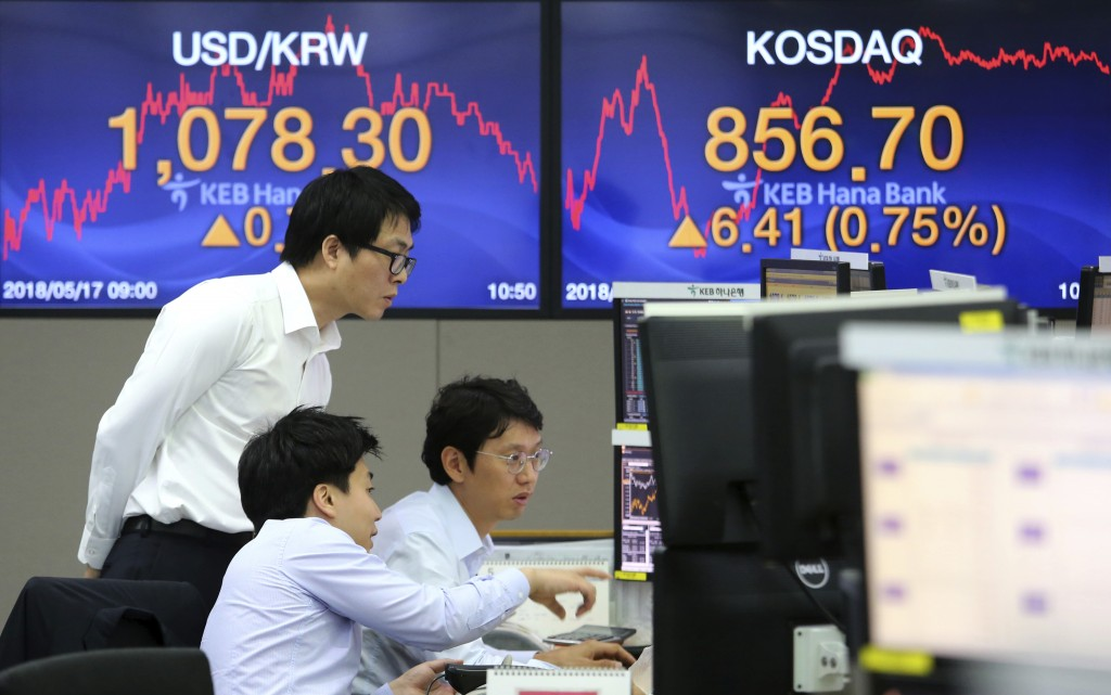 Currency traders watch monitors at the foreign exchange dealing room of the KEB Hana Bank headquarters in Seoul, South Korea, Thursday, May 17, 2018. ...