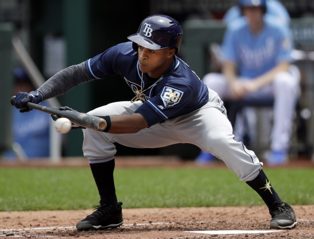Tampa Bay Rays' Mallex Smith bunts for a single during the fourth inning of a baseball game against the Kansas City Royals at Kauffman Stadium in Kans