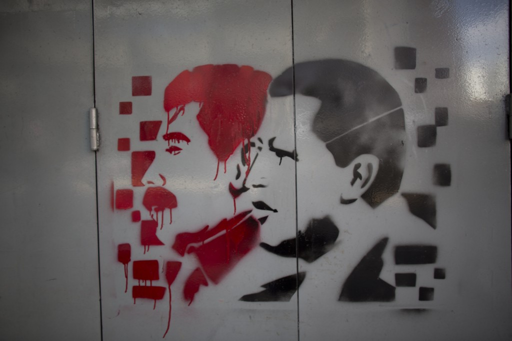 A gate is covered with images of Venezuela's late President Hugo Chavez, right, and current President Nicolas Maduro, ahead of the presidential electi
