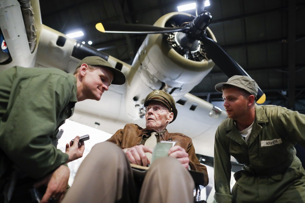 """United States Air Force (Ret.) Col. Howard Hunt, center, meets with Memphis Belle fans during the private viewing of the Boeing B-17 """"Flying Fortress"""""""